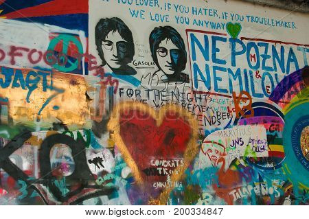 PRAGUE, CZECH REPUBLIC - AUGUST 16, 2017: Various pictures and text messages decorated the John Lennon wall in Prague, which is very popular among young artists and tourists