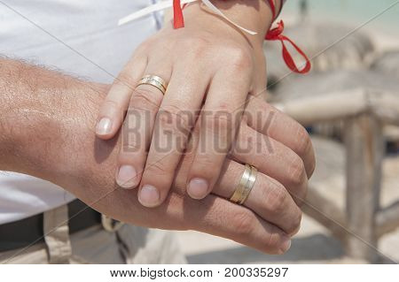 Newly Married Couple Showing Off Their Wedding Rings