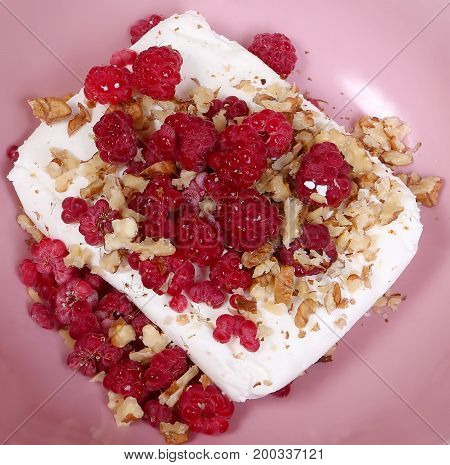 Healthy breakfast with cottage cheese raspberry and walnut