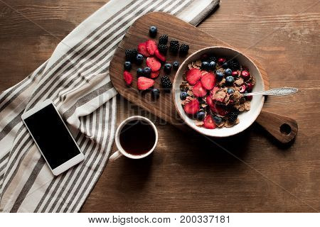 Flakes With Berries And Smartphone
