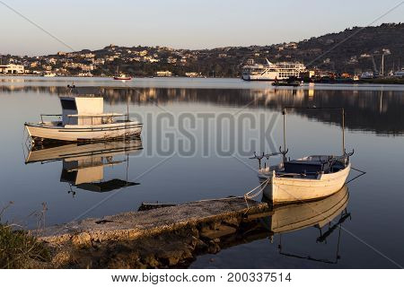 The view of the sea and the boats moored in the evening light