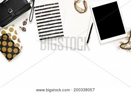 Flat Lay Photo Of Stylish Office White Desk With Wallet, Women's Jewelry, Keyboard And Gold Notebook