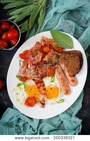 English Breakfast - Fried Egg, Sausage, Tomatoes, Bacon And Toast. Top View. Flat Lay