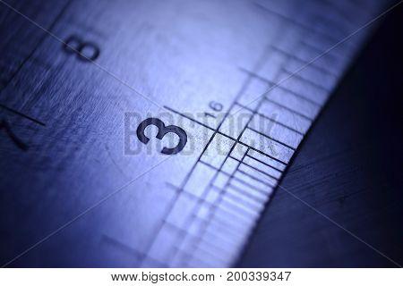 ruler with number threein focus soft backgorund