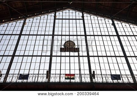 Hungarian and European flag hung on the main window of Nyguati Palyaudvar train station. Despite heavy criticism Hungary remains one of the main Central European members of the EU
