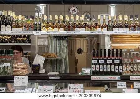 BUDAPEST HUNGARY - AUGUST 12 2017: Bottles of Tokaji wine and other traditional Hungarians drinks and foods for sale in Budapest central market Nagy Vasarcsarnok