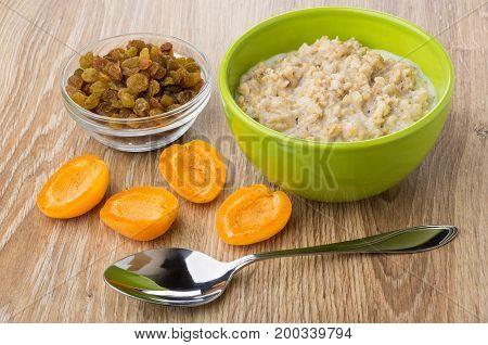 Porridge From Oat Flakes With Milk In Bowl, Raisins, Apricot