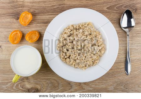 Porridge From Oat Flakes, Milk In Cup, Pieces Of Apricots