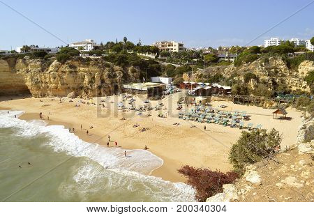Senhora da Rocha Algarve Portugal - October 2 2014: Tourists on Senhora da Rocha beach fishing village