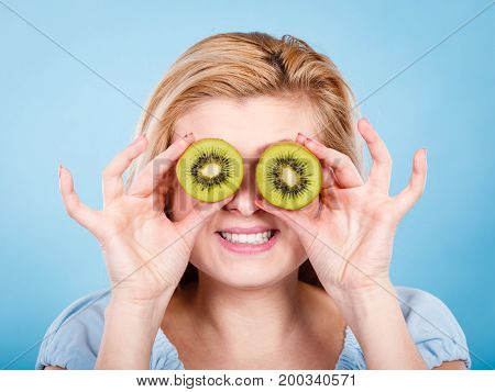 Woman Holding Green Kiwi Fruit Like Eyeglasses