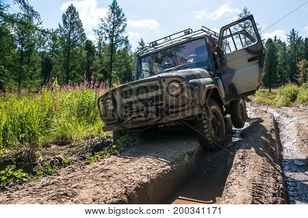 Suv Stuck In A Rut On A Bad Impassable Road In The Woods Of Siberia