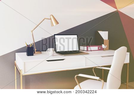 Black red yellow and white geometric wall pattern home office with a wooden floor a square poster a laptop and a white chair near a computer table. Close up. 3d rendering mock up toned image