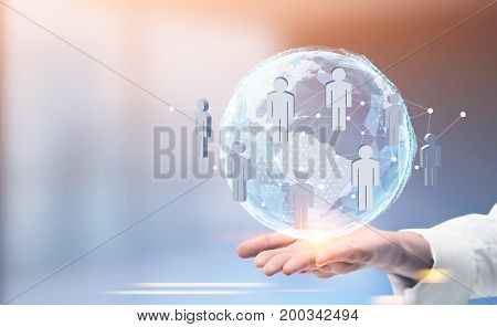 Close up of a hand of an unrecognizable man holding an Earth hologram with a network sketch. Blurred office background. Toned image double exposure mock up