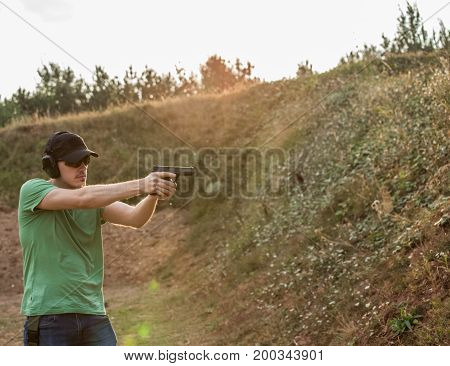 Handsome And Muscular Caucasian Handsome Guy Firing Furiously From Fire Gun Glock Pistol Violent Har