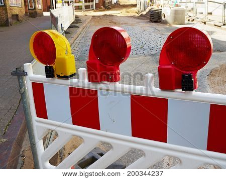 Construction road work side street warning caution flashing red light lamps