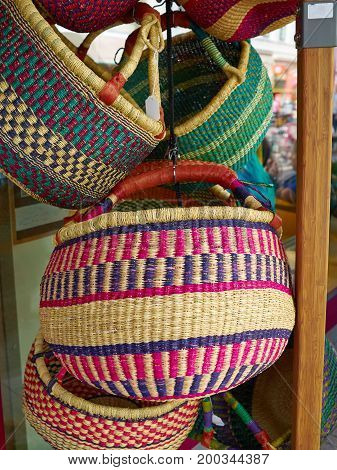 Colorful woven handmade classical traditional African Caribbean baskets for sale in a market