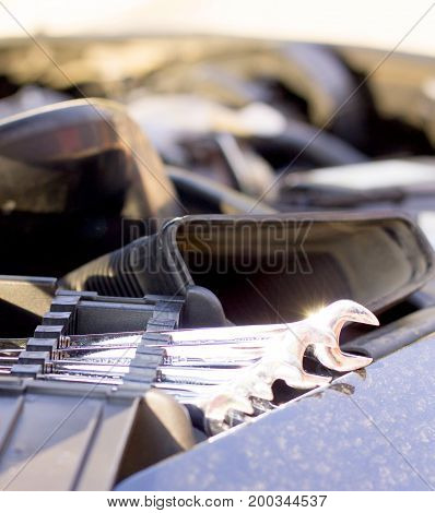 Useful fixing utensils for broken car - metal wrench.