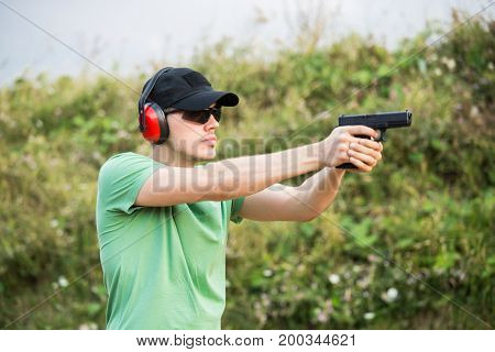 Special Force Policeman Soldier From Military Army Camp Wants To Shoot The Enemy With Gun Glock Dese