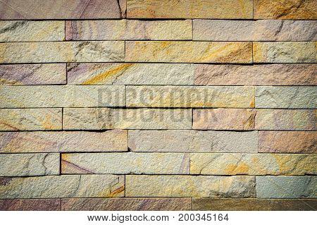 Yellow Brick Wall Texture Background.