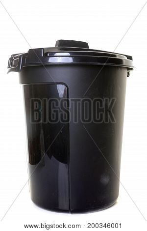 Plastic garbage bin in front of white background