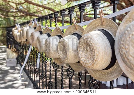 Straw hats for wedding decoration. Fense .Close-up