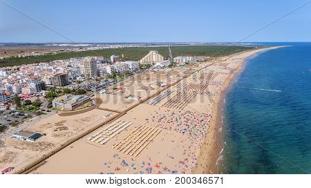 Aerial. Photo from the sky of the Monte Gordo beaches, shot from the drone. Portugal, Algarve