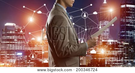 Close of businessman holding papers in hand and connection lines at background