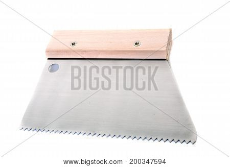 trowel for tiles in front of white background