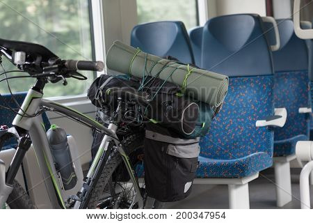 Mountain Bike With Saddlebags Is Transported In The Train.