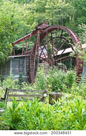 a large metal wheel powers this gristmill