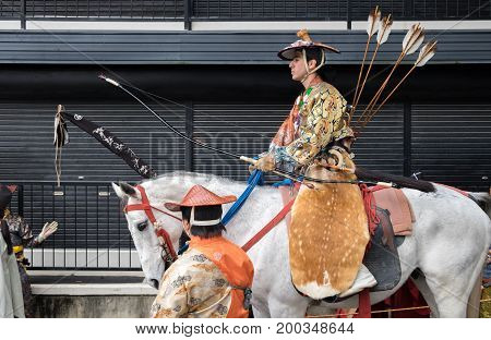 TADO SHRINE , KUWANA, JAPAN - NOVEMBER 23, 2015: Participants of Festival Yabusame - a type of mounted or horseback archery in traditional Japanese style