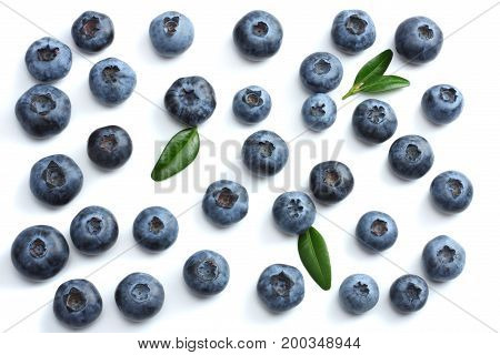blueberries with green leaf isolated on white background