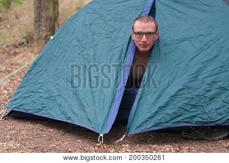 Topless Man Gets Up In The Morning In His Camping Tent