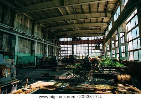 abandoned factory, empty workplace overgrown with plants