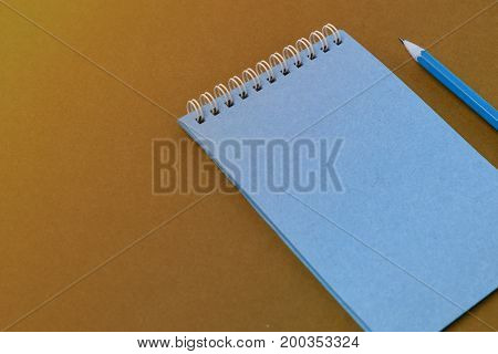 Top view of open spiral blank notebook with pencil on  paper background. Open vintage notebook. Empty notebook paper for text with  pencil . office concept top view.Copy space. Space for text