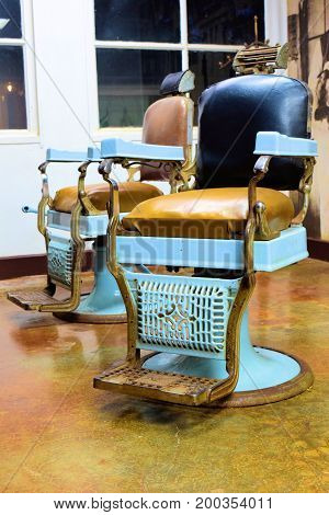 Vintage barber shop chairs on display as decorative antique collectable furniture