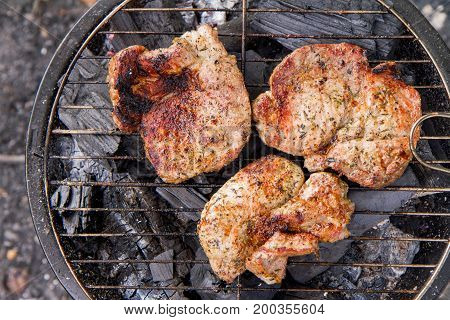 Some nice chuck steak being grilled, outdoors