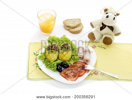Children's meal - stuffed with potatoes, vegetables and bacon on the table close-up