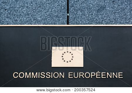 Kirchberg, Luxembourg - July 1, 2017: European commission sign on a wall. The European Commission is an institution of the European Union responsible for proposing legislation, implementing decisions and upholding the EU treaties