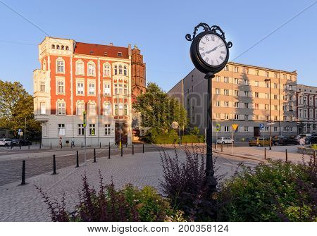 Town clock in central part of Gliwice Poland Europe. during sunset.