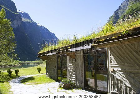 Green mountains and Waterfalls in Sognefjord Scandinavia. View of the hotel. Norway
