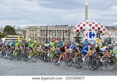 Paris France - 23 July 2017: The peloton including Froome in Yellow Jersey and the second overall Rigoberto Uran of Canondale-Drapac Team riding in Place de la Concorde in Paris during the last stage of Le Tour de France 2017.