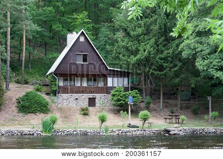 Cottage On The Bank Of The River Jihlava, Czech Republic In The Summer Day.