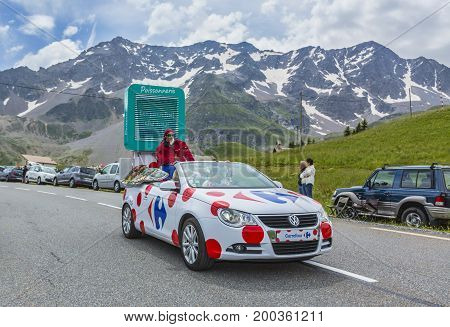 Col du Lautaret France - July 19 2014: The vehicle of Carrefour during the passing of the advertising caravan on mountain pass Lautaret during the stage 14 of Le Tour de France 2014. Before the appearance of the cyclists there is a caravan of advertising