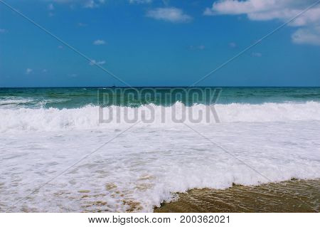 Waves of the Mediterranean Sea are rolling ashore (Alanya, Turkey).