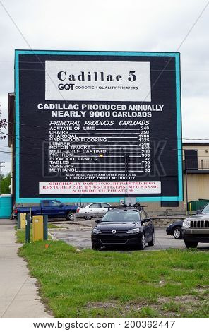 CADILLAC, MICHIGAN / UNITED STATES - MAY 31, 2017:  A large mural, on the back of the building of the Cadillac 5 Goodrich Quality Theater, in downtown Cadillac, lists the number of carloads of various products produced annually in Cadillac in 1920.