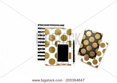 Flat Lay Photo Of Minimalistic White Office Desk With Phone And Stylish Gold Notebooks Copy Space Ba