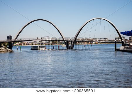 WESTERN AUSTRALIA, PERTH - NOVEMBER 2016: A view of Elizabeth Quay Bridge and ferry sailing underneath