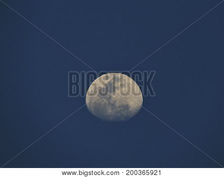 Moon in a blue sky at afternoon