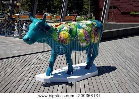 WESTERN AUSTRALIA, PERTH - NOVEMBER 2016: Colorful Blue painted cow at Elizabeth Quay as part of CowParade event